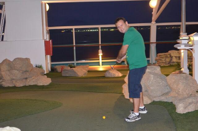 jogar golfe