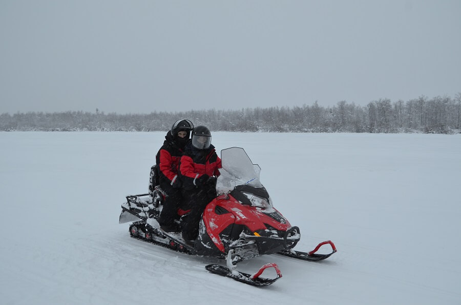 Driving a snowmobile in Lapland Finland